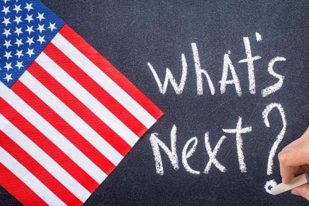What's next on the chalk board and US flag. Election concept
