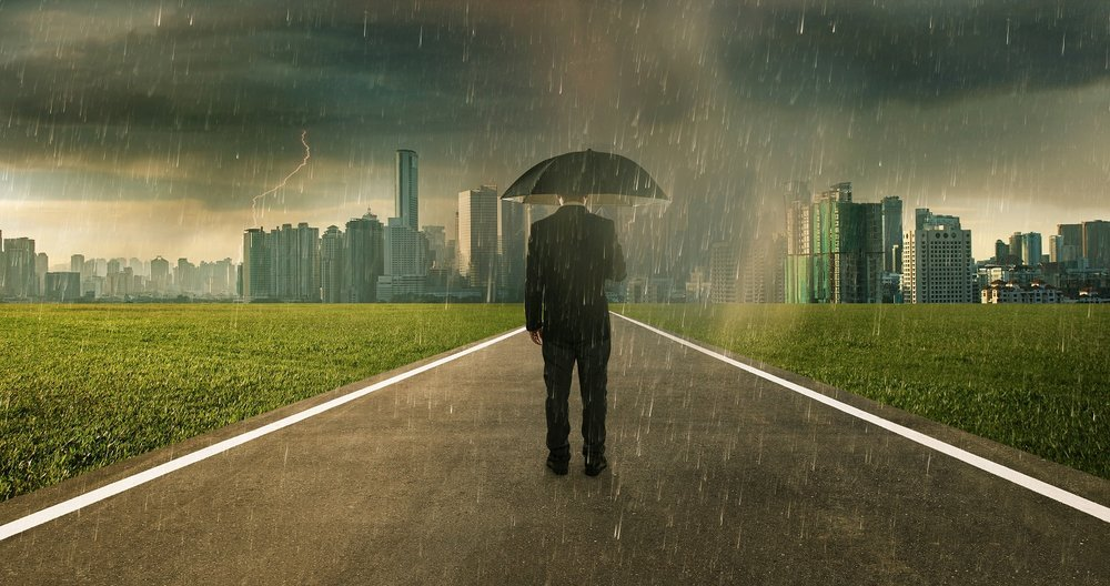 graphicstock-businessman-below-storm-rain-with-umbrella-risk-and-crisis-concept_r_Hgr1hPeoe-sm.jpg