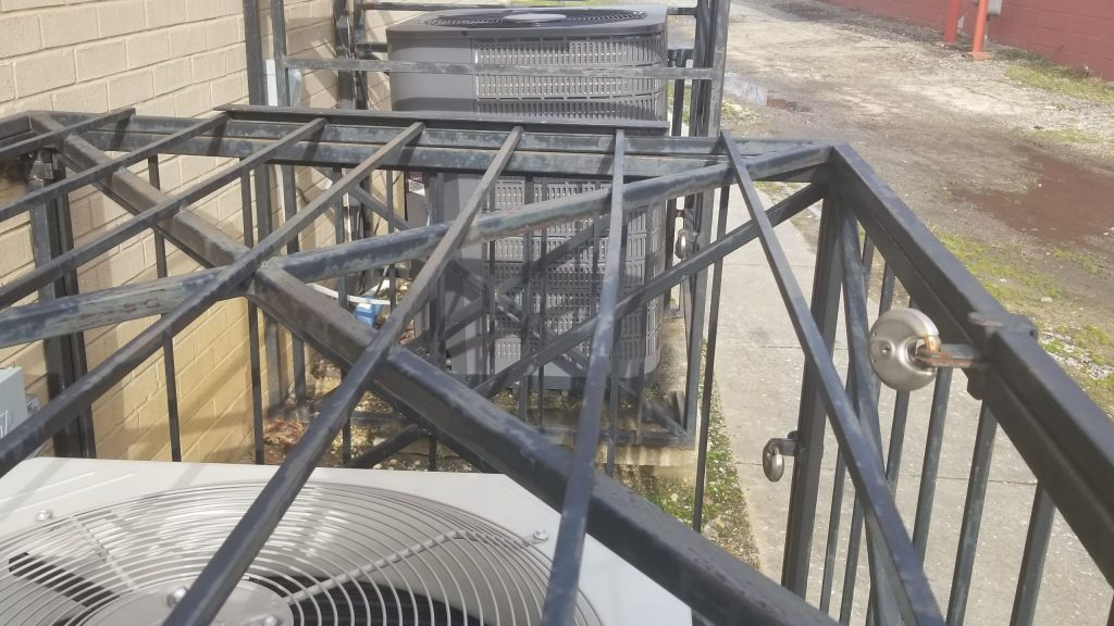 HVAC unit secured behind cage and lock