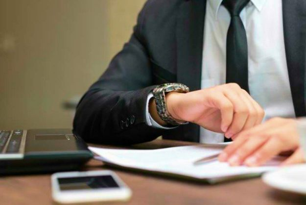 businessman sitting looking at his watch | Foreclosure: Understanding The Process | What is foreclosure