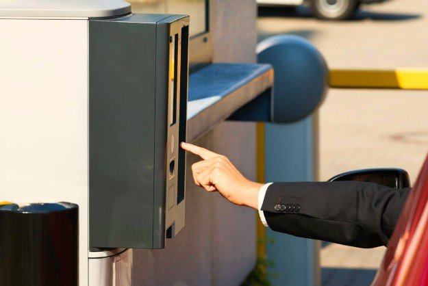 person sitting car using parking machine   Understanding Commercial Real Estate Loan Underwriting   what is underwriting