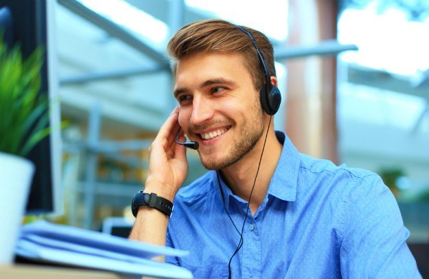 smiling friendly handsome young male call making notes | Proven Follow Up Techniques to Close The Sale | sales follow up