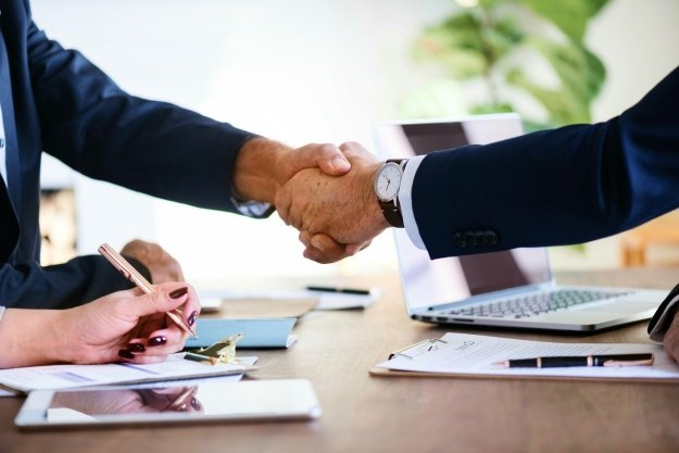 handshake business wristwatch achievement | Commercial Real Estate Sale and Purchase Agreement | Everything You Need To Know | purchase agreement template